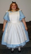 customer wearing Alice in Wonderland plus size Halloween costume in light blue