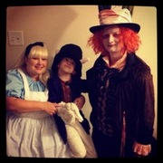 customer wearing plus size Alice in Wonderland Halloween costume