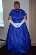 customer wearing plus size custom made Cinderella fairy tale princess Halloween costume in sparkle blue with white sash gloves tiara