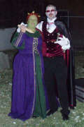 customer wearing plus size Renaissance Fiona Halloween costume from Shrek with Dracula vampire