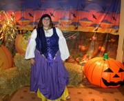 customer wearing Fortune Teller Gypsy plus size Halloween costume in purple and gold