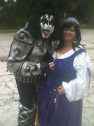 customer wearing plus size Renaissance Fortune Teller Gypsy Halloween costume in purple with Gene Simmons Kiss costume