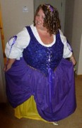 customer wearing plus size Renaissance Fortune Teller Gypsy Halloween costume in purple