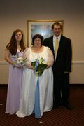 customer wearing plus size Renaissance Garden Wedding Gown dress in white and blue satin with organza embroidered sleeves