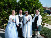 customer wearing plus size Renaissance Garden Wedding Gown dress in white and lilac satin with Bridesmaid gown in lilac with Scottish highlander and pirate at historical wedding ceremony