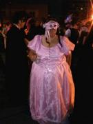 customer wearing plus size pink Glinda the good witch Halloween costume from the Wizard of Oz for Venetian masquerade ball with mask