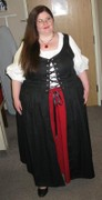 customer wearing plus size Renaissance Irish Overdress dress gown in black with white peasant shirt chemise and red underskirt skirt