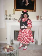 customer wearing Miss Minnie Mouse plus size Halloween costume in red white polka dots