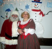 customer wearing plus size Mrs. Santa Claus Christmas costume - Scottish Lass gown dress with red bodice and red plaid tartan skirt