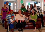customer wearing plus size Renaissance Pirate Halloween costume with family at pirate themed party