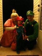 customer wearing plus size Princess Peach Halloween Cosplay Comicon Nintendo costume from Super Mario Bros. (custom order) with Luigi and Mario