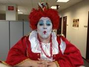 customer wearing plus size deluxe Queen of Hearts Halloween costume