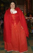customer wearing plus size Renaissance Full-length Red Riding Hood Halloween costume with polka dot dotted skirt and hooded cape