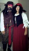 customer wearing plus size Renaissance gown dress outfit with burgundy skirt and mop cap used as pirate Halloween costume with Captain Jack Sparrow from Pirates of the Caribbean