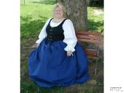 customer wearing plus size Renaissance Starter gown dress with bright blue skirt and black corset bodice