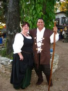 customer wearing plus size Renaissance gown dress outfit garb in black with hunter green skirt at faire