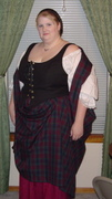 customer wearing plus size Scottish Lass Renaissance historical dress gown outfit with tartan plaid shawl and burgundy skirt