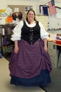 customer classroom teacher wearing plus size Renaissance Scottish Lass gown dress outfit tartan plaid Package with navy blue skirt for educational historical hands-on lesson