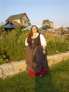customer wearing plus size Renaissance Scottish Lass dress gown tartan plaid package with dark red skirt