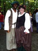 customer wearing plus size Renaissance Scottish Lass historical gown dress outfit with tartan plaid skirt at faire