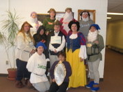 customer wearing plus size Renaissance Snow White Halloween costume with seven dwarves and evil queen and magic mirror