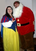 customer wearing plus size Renaissance Snow White Halloween costume with Grumpy seven dwarves dwarf