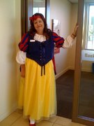 customer wearing plus size Snow White full-length Halloween costume with sparkle tulle overlay skirt