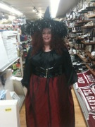 customer wearing plus size Renaissance Vampiress Vampire Witch Halloween costume with blood red wine silk skirt and pvc waist cincher
