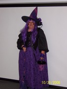 customer wearing plus size Renaissance Spooky Purple Witch Halloween costume with velvet flocked spiderwebs broom hat