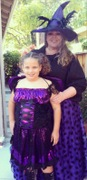 customer wearing plus size Renaissance Spooky Purple Witch Halloween costume