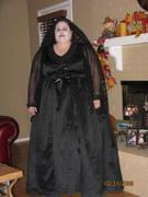 customer wearing plus size Witchy Witch Woman Vampiress Vampire Halloween costume in black satin with gothic batwing sleeves in chiffon
